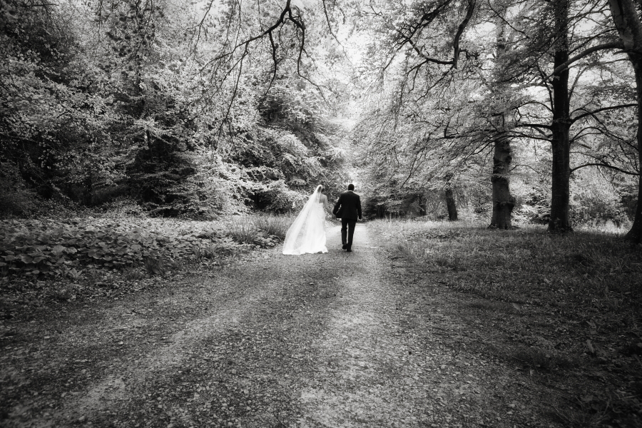 black and white image, bride and groom, adare woods, bride and groom in forest