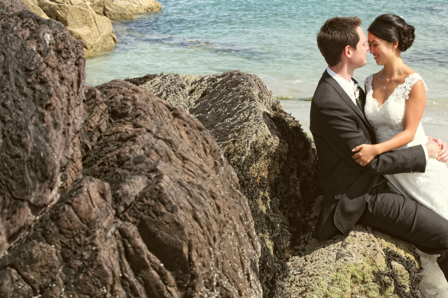 beach weddings, rocks, bride and groom up close