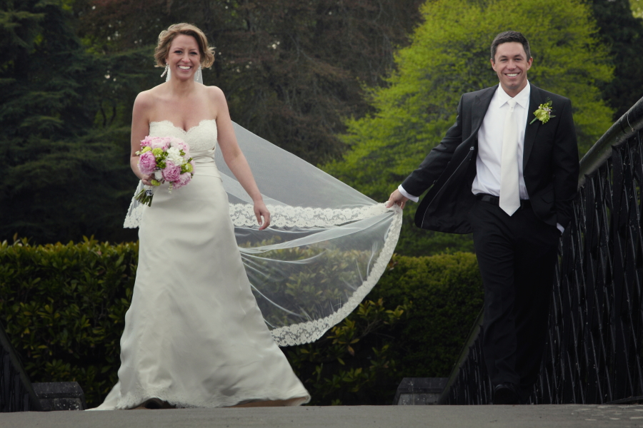 bride and groom on bridge, adare manor wedding