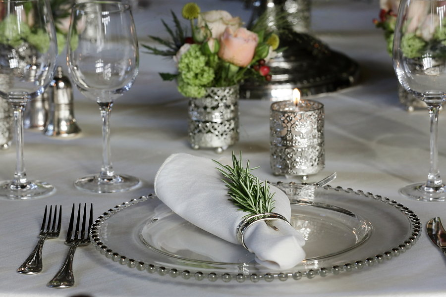place setting glass beaded charger & rosemary in napkin ring